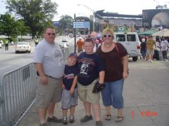 phillips family at braves game  this past summer.  wow how my husband and i have changed!!