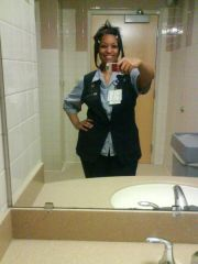 Me at work trying to be cute in this hideous uniform...